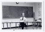 Mr. McCaslin seated at a desk