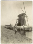 Man standing in front of a windmill