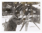 A Man Operating Photography Equipment