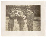 Three Soldiers lighting cigarettes