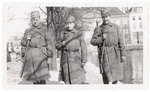 Three soldiers posing for photograph
