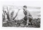 Soldier sitting on brush