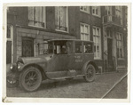 Automobile in front of building 64