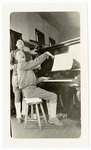 Two soldiers at piano