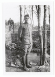 Soldier standing in beside small river