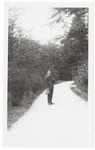 Man standing on gravel path