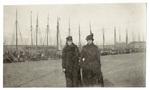 Two women posing in harbor