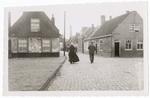 People walking on brick street