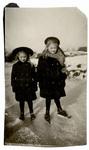Two girls wearing ice skates