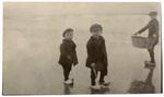 Three boys on beach