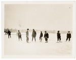 Men standing in snowy field