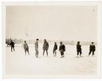 Men standing in snowy field