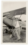 Man with cane standing by plane