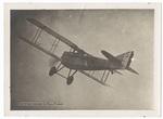 3/4 view of biplane in flight