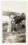 Man and woman with biplane