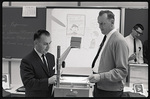 Men standing at an overhead projector by The Center for Teaching and Learning