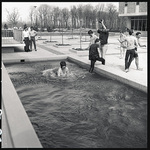 Students on April Day in reflecting pool by The Center for Teaching and Learning