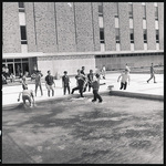 Students on April Day in reflecting pool